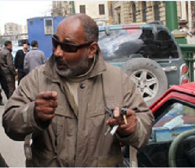 هشام الشاذلى مفجر بلاغ حرق المجمع العلمى