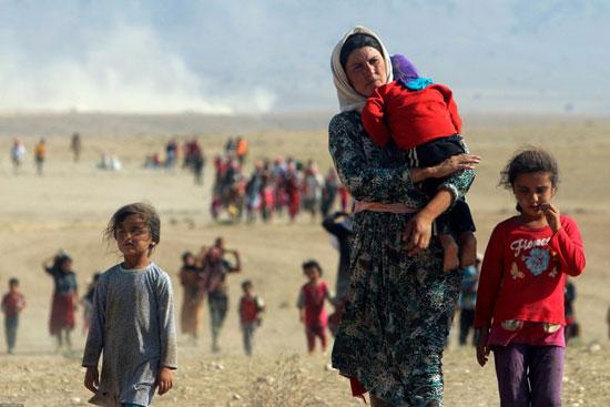 أطفال-سوريا-يفرون-من-نيران-العدوان-التركى