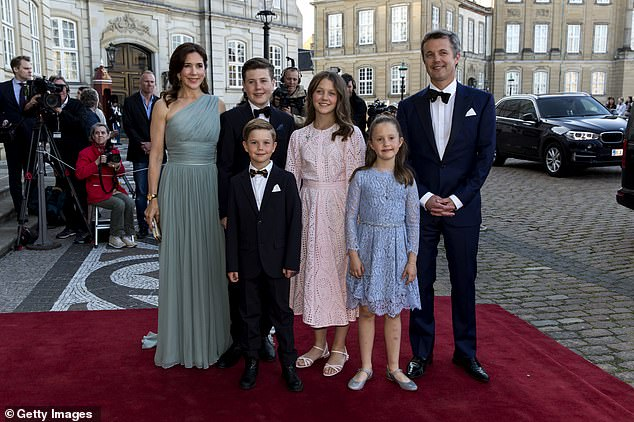 14521802-7557919-Crown_Prince_Frederik_and_Crown_Princess_Mary_and_their_four_chi-a-69_1570700153183