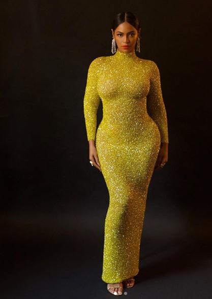 بيونسية بفستان أصفر من ابداع يوسف الجسمي