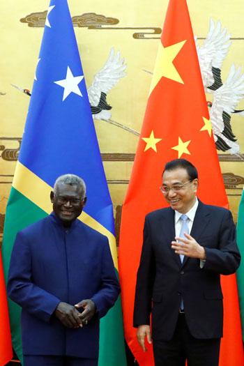 رئيس-وزراء-جزر-سليمان-ورئيس-مجلس-الدولة-الصينى