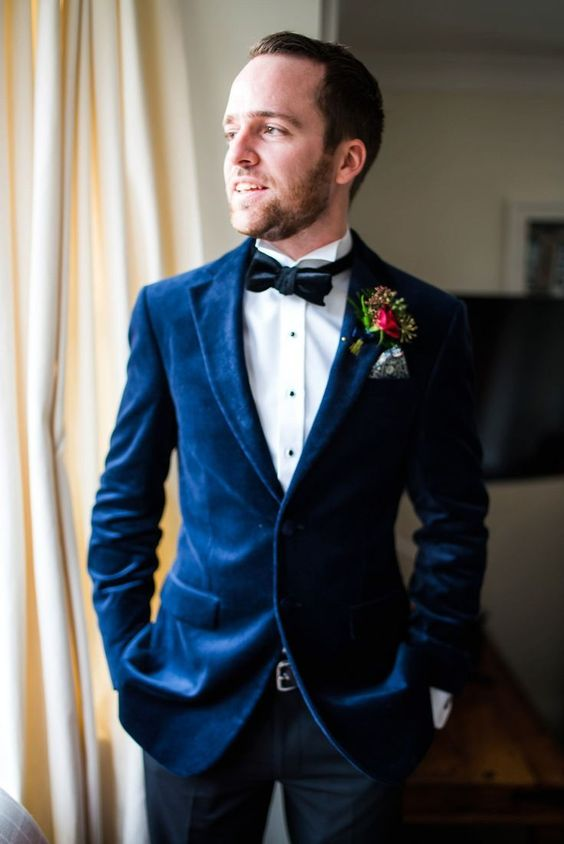 a-glam-look-with-a-bright-blue-velvet-blazer-a-black-velvet-bow-tie-and-navy-pants-for-a-fall-wedding