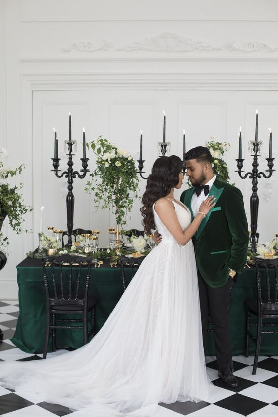a-sophisticated-green-velvet-tux-with-light-green-lapels-a-black-bow-tie-and-black-pants
