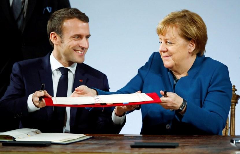 ماكرون وميركل يوقعان معاهدة آخن التى اعتبرها البعض نواة الجيش الأوروبى الموحد