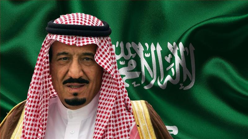 الملك سلمان وخلفه علم بلاده