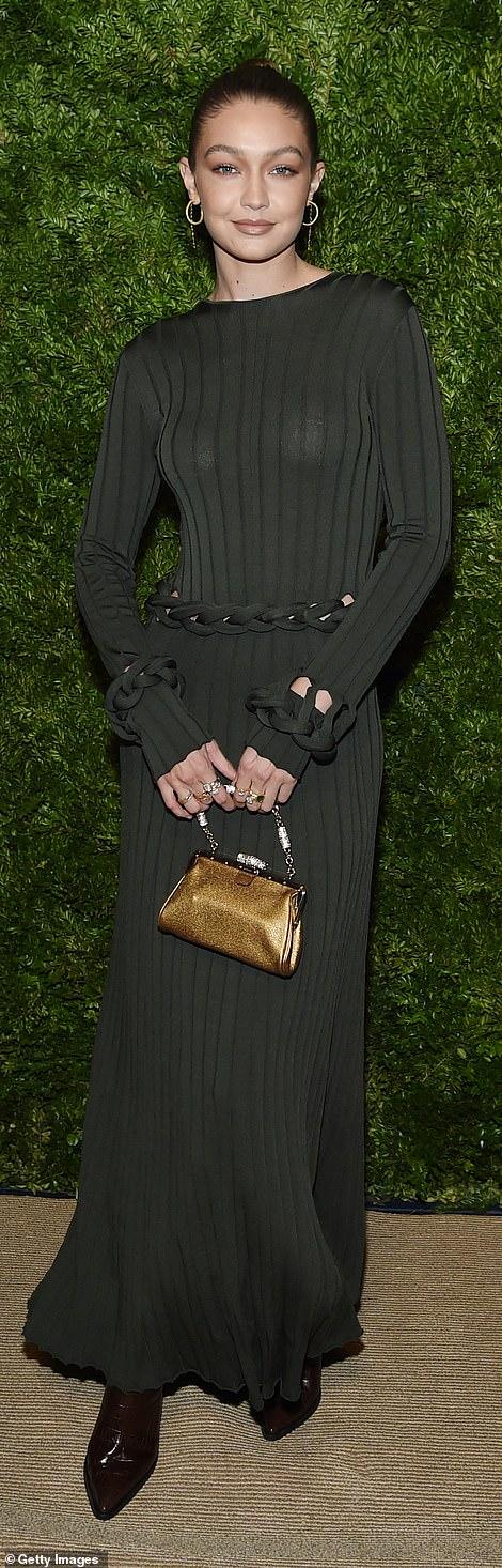 20605638-7649921-Fashion_siblings_Gigi_Hadid_24_showed_off_a_reserved_sheer_dress-a-8_1572923815136