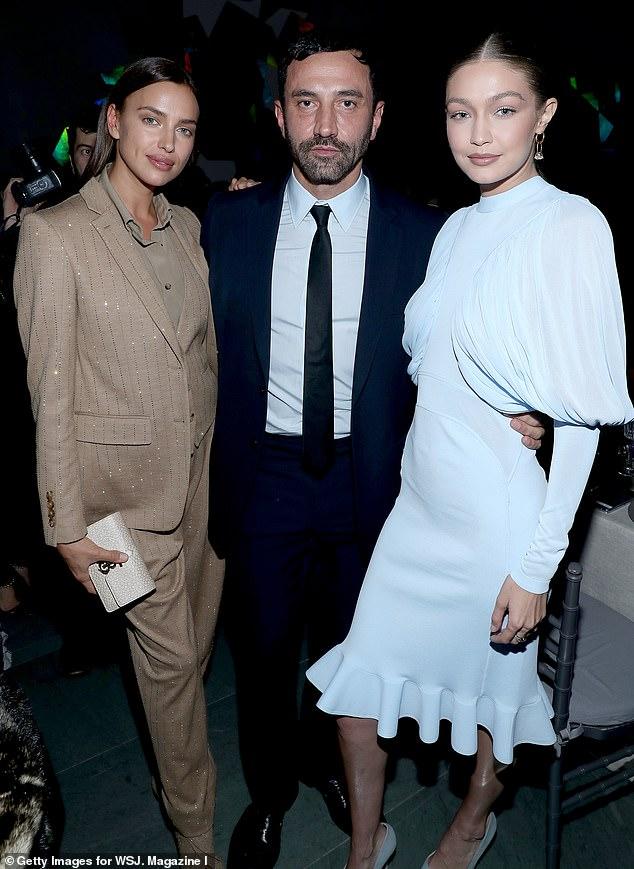 جيجى مع ايرينا شايك ومصمم الازياء  بربري ريكاردو تيسي