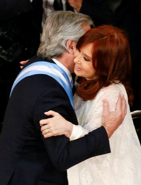 Alberto Fernandez hugs his wife