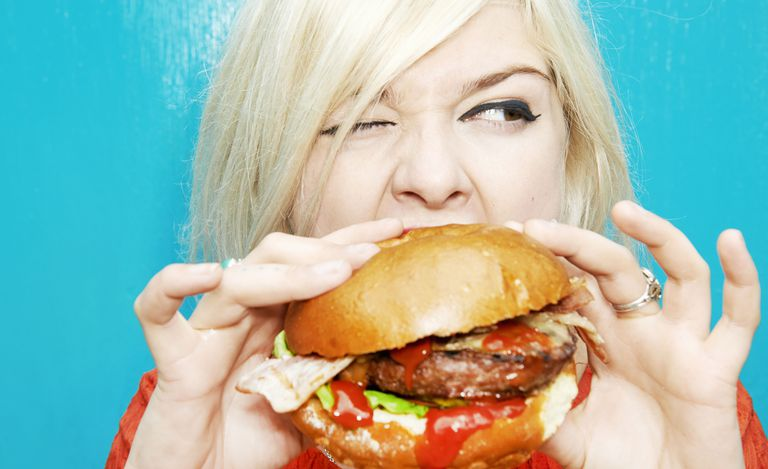 1460645894-woman-eating-burger