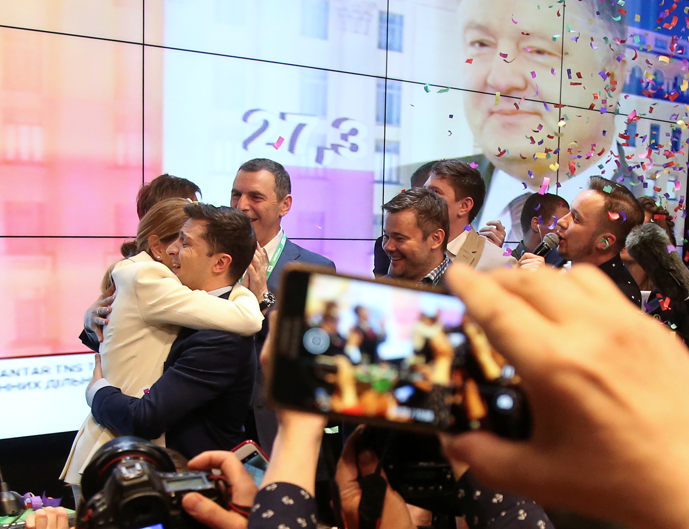Volodymyr Zelensky embraces his wife