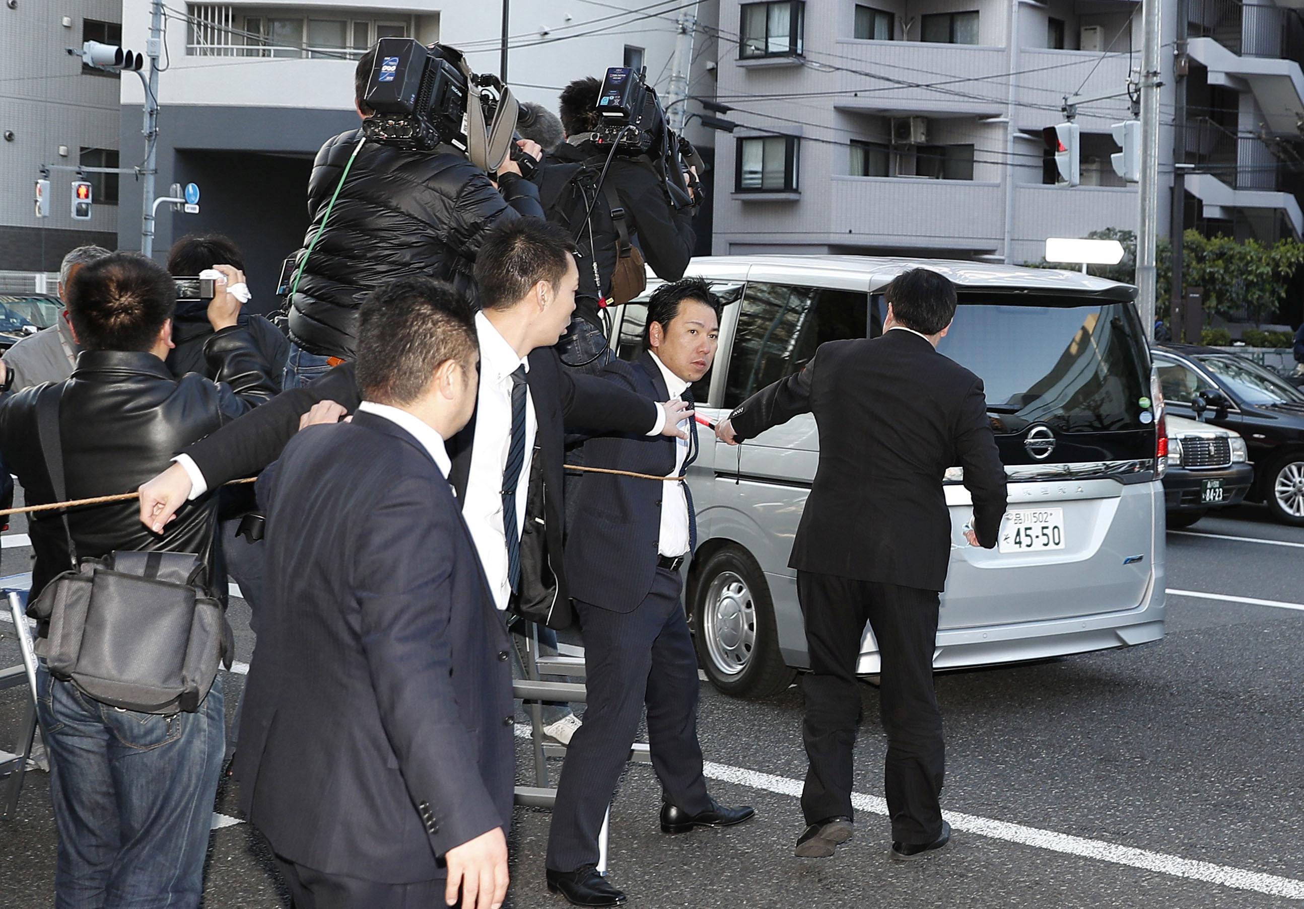 أثناء نقل كارلوس غصن للمعتقل