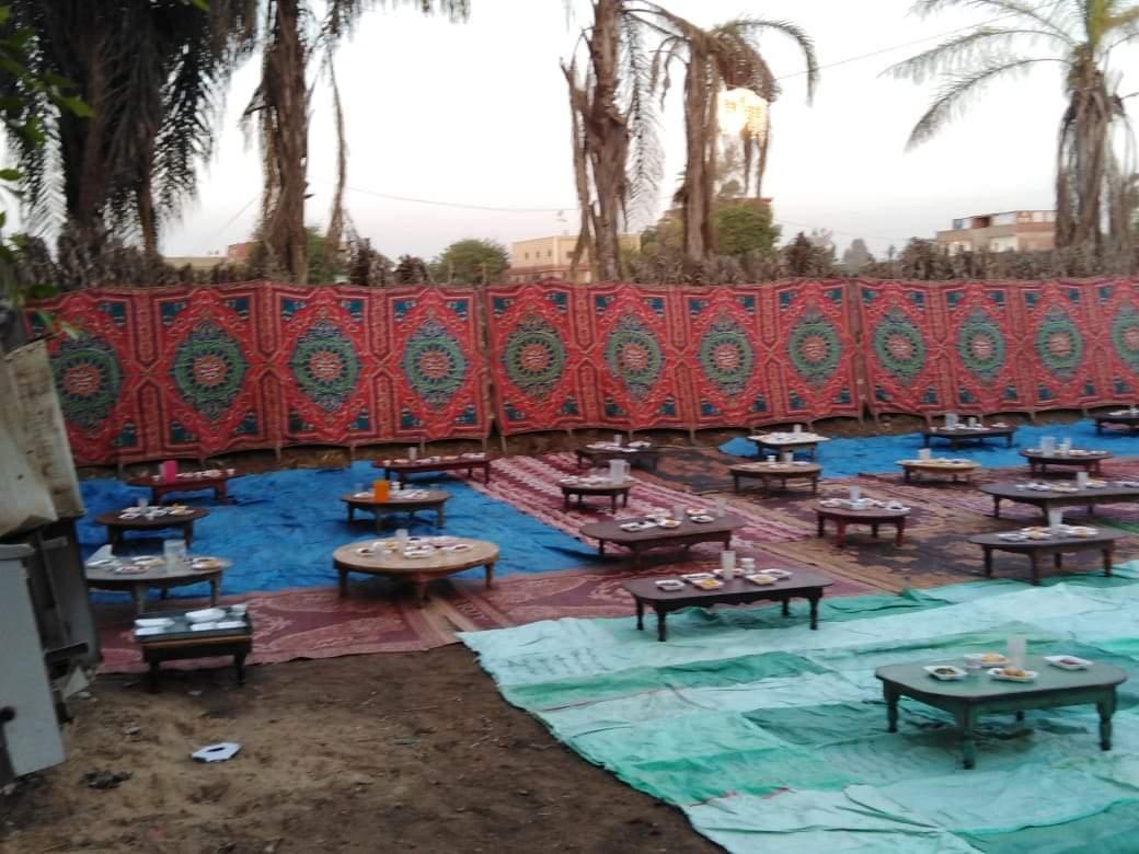 أقباط أشقاء بالمنوفية ينظمون مائدة إفطار للمسلمين (2)