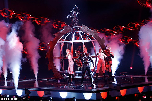13666410-7045695-Participant_Hatari_of_Iceland_performs_during_the_Grand_Final_of-a-8_1558226967645