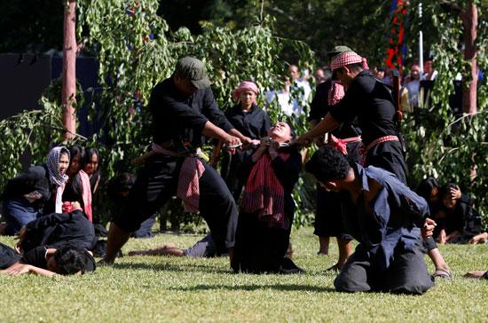 إعادة تمثيل مجازر الخمير الحمر ضد الكمبوديين يوم الغضب  (7)