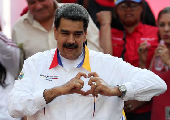 احتفالات بالذكرى السنوية الأولى لإعادة انتخاب مادورو رئيسا لفنزويلا (10)