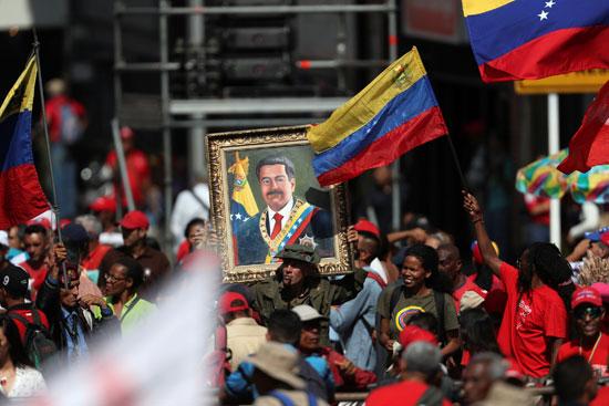 احتفالات بالذكرى السنوية الأولى لإعادة انتخاب مادورو رئيسا لفنزويلا (9)