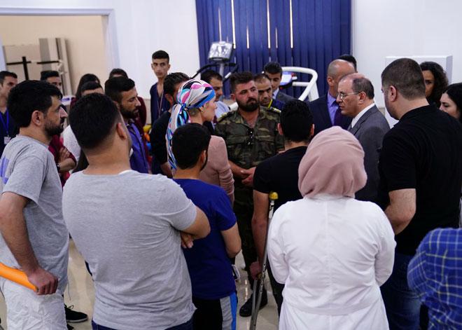 السيدة أسماء الأسد  مركز الأطراف الاصطناعية في مدينة حماة .66