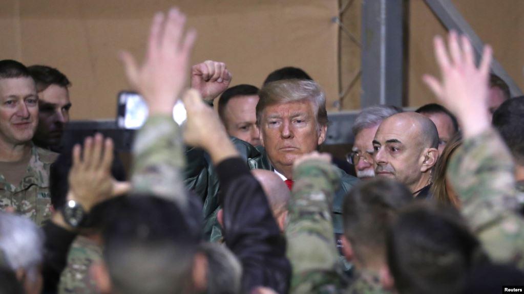 ترامب فى زيارة سابقة لأحد القواعد الأمريكية فى العراق