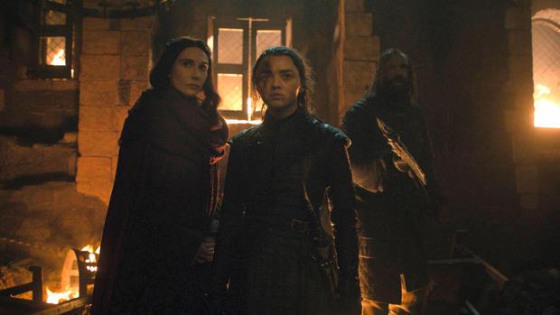 Melisandre and Maisie Williams as Arya Stark