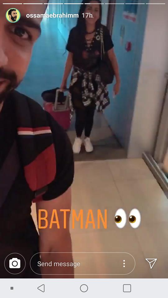 اسامة ابراهيم وزوجته في مطار القاهرة