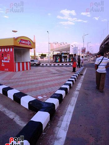 6201911101744870-تخطيط-الشوارع-ودهان-الأرصفة-بمحيط-استاد-القاهرة--(7)
