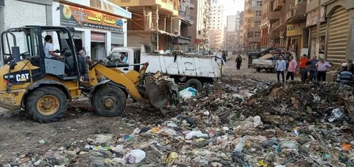 حملات لرفع القمامه بشوارع المحلة
