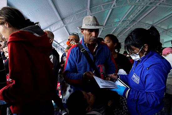 2019-06-13T191938Z_162956697_RC1824900D70_RTRMADP_3_VENEZUELA-MIGRATION-ECUADOR
