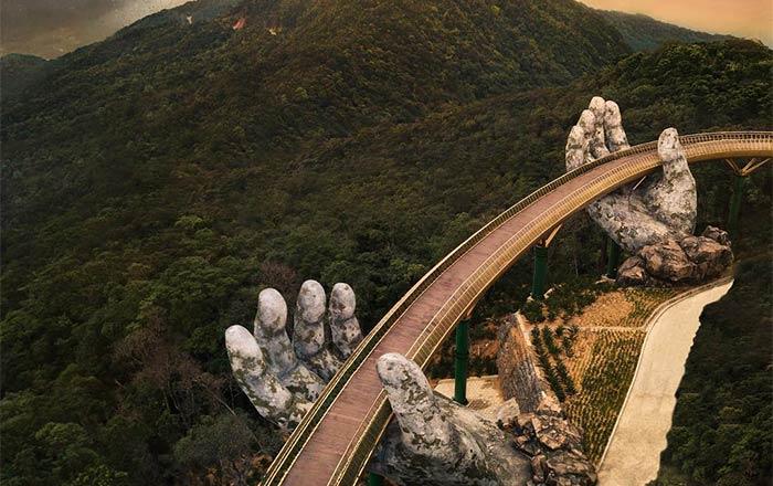 بين إيدين الجبل.. الجسر الذهبى فى فيتنام أجمل جسور العالم 72372-AKH2-alti