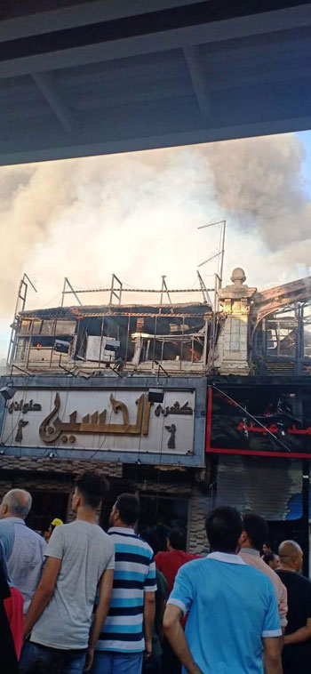 حريق بسوق الخضار بالموسكى (4)