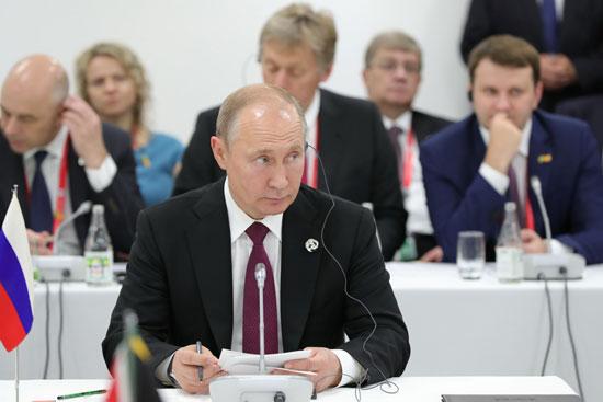 بوتين عقب وصوله إلى مقر قمة العشرين