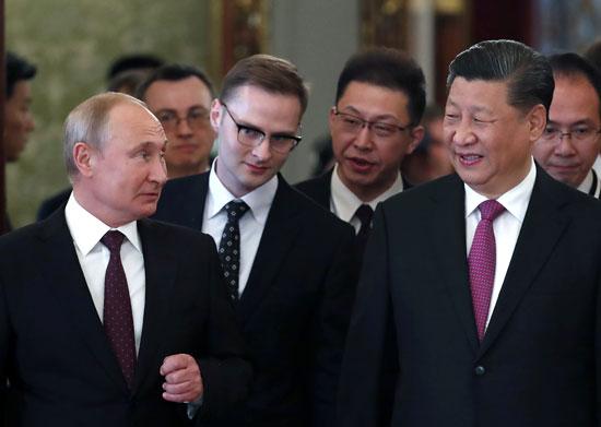 جانب من لقاء بوتين وشى جين بينج