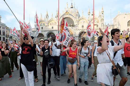 protesters walk through the streets of Venice