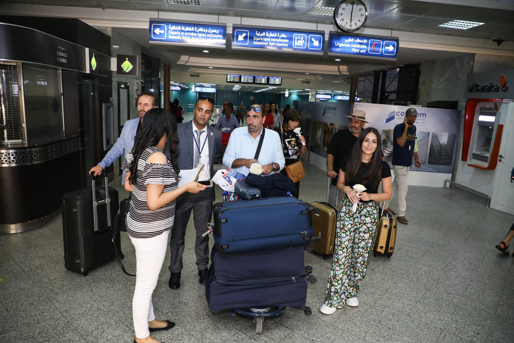 هبة طوجي وأسامة الرحباني في مطار تونس