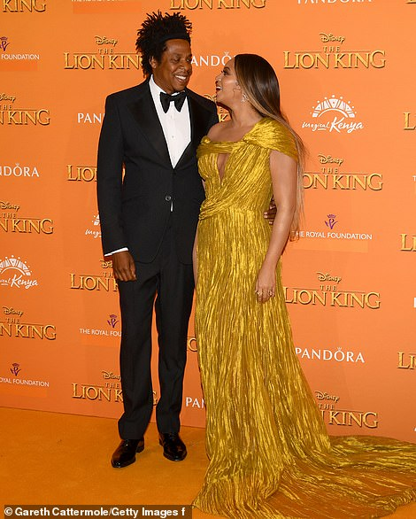 16039926-7246349-Leading_the_pride_Beyonc_was_joined_by_her_husband_Jay_Z_49_who_-m-148_1563128951267