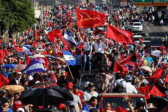 2019-08-10T015743Z_1322364664_RC1AC6E3BC90_RTRMADP_3_HONDURAS-PROTESTS-(1)