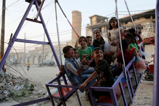 الأطفال-يحتفلون-بالعيد-فى-العراق