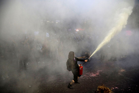 Protesters burned a police station