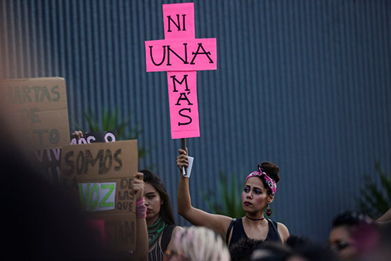 A demonstrator holds an anti-police sign