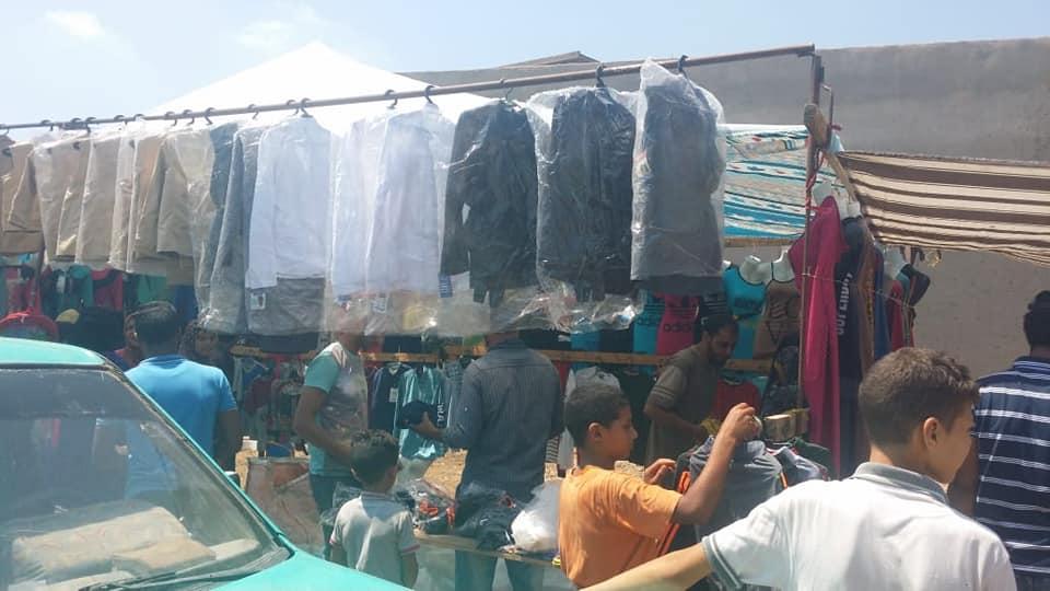 قافلة لتوفير السلع الغذائية والملابس  (2)