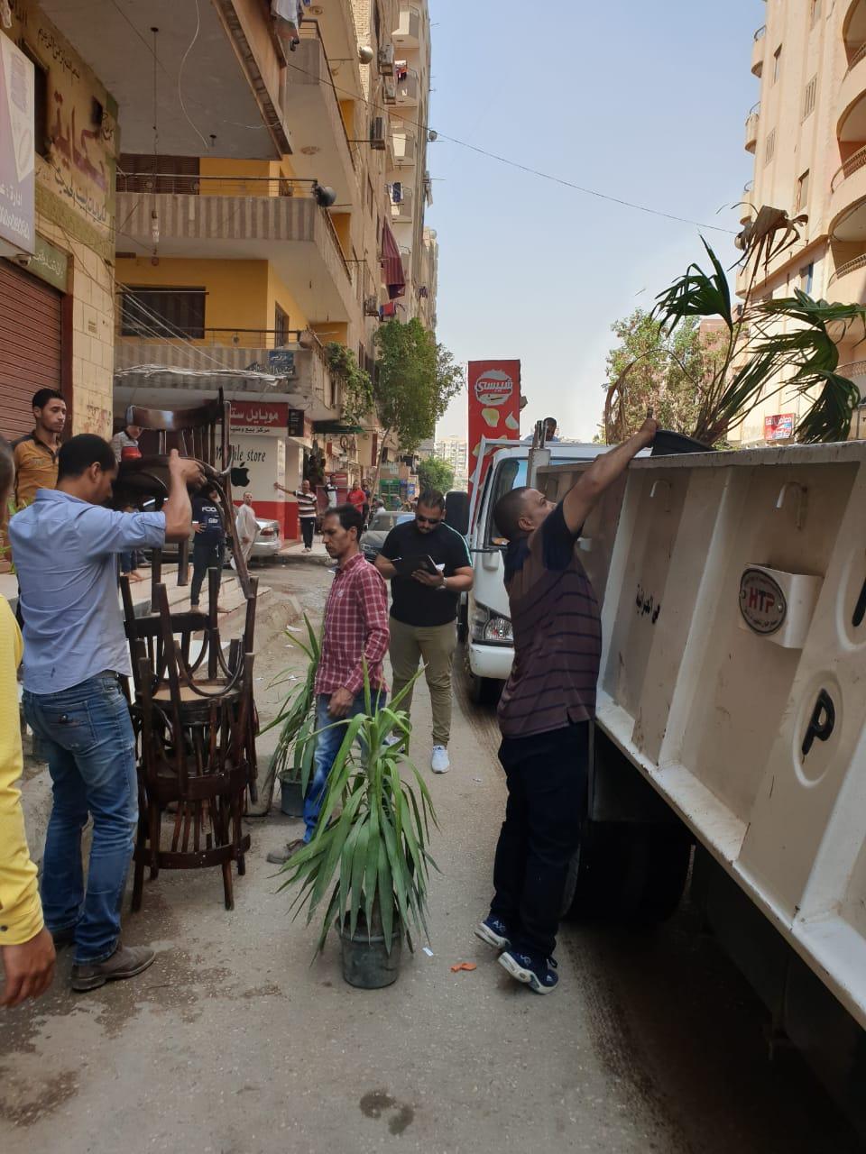 رفع الإشغالات بالعجوزة والطالبية وإصلاح كسر ماسورة مياه جنوب الجيزة  (4)