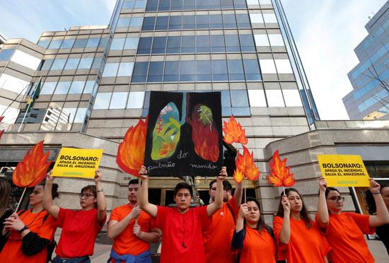 2019-08-23T231709Z_1402950876_RC1EA72CA220_RTRMADP_3_BRAZIL-ENVIRONMENT-PROTESTS-CHILE