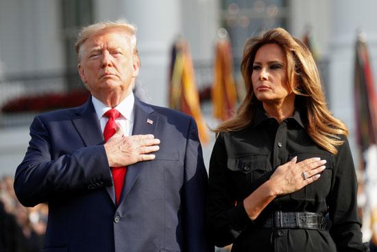 ترامب وزوجته خلال عزف النشيد الوطنى