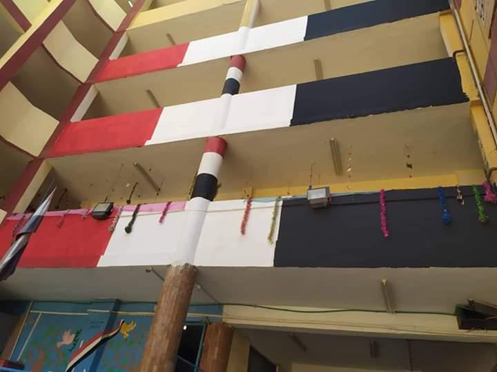 مدارس الجيزة تتزين بالأعلام استعدادا للعام الدراسي الجديد (4)