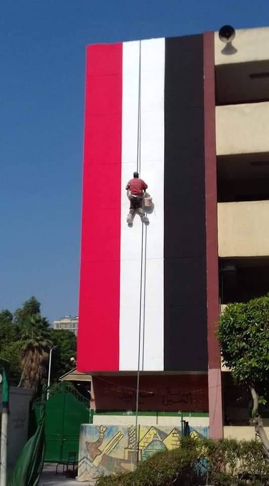 مدارس الجيزة تتزين بالأعلام استعدادا للعام الدراسي الجديد (2)