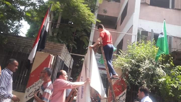 مدارس الجيزة تتزين بالأعلام استعدادا للعام الدراسي الجديد (12)