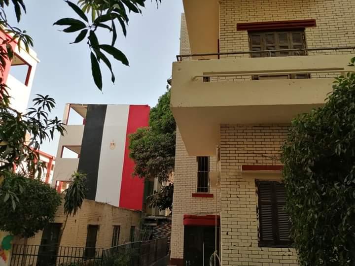 مدارس الجيزة تتزين بالأعلام استعدادا للعام الدراسي الجديد (9)