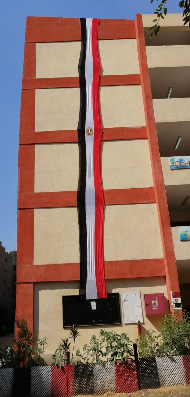 مدارس الجيزة تتزين بالأعلام استعدادا للعام الدراسي الجديد (14)