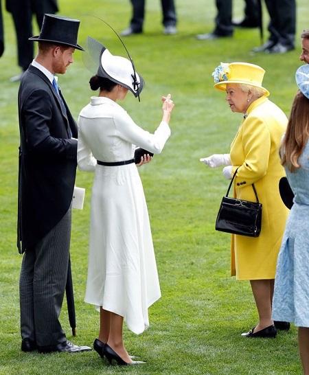 الملكة مع ميجان ماركل