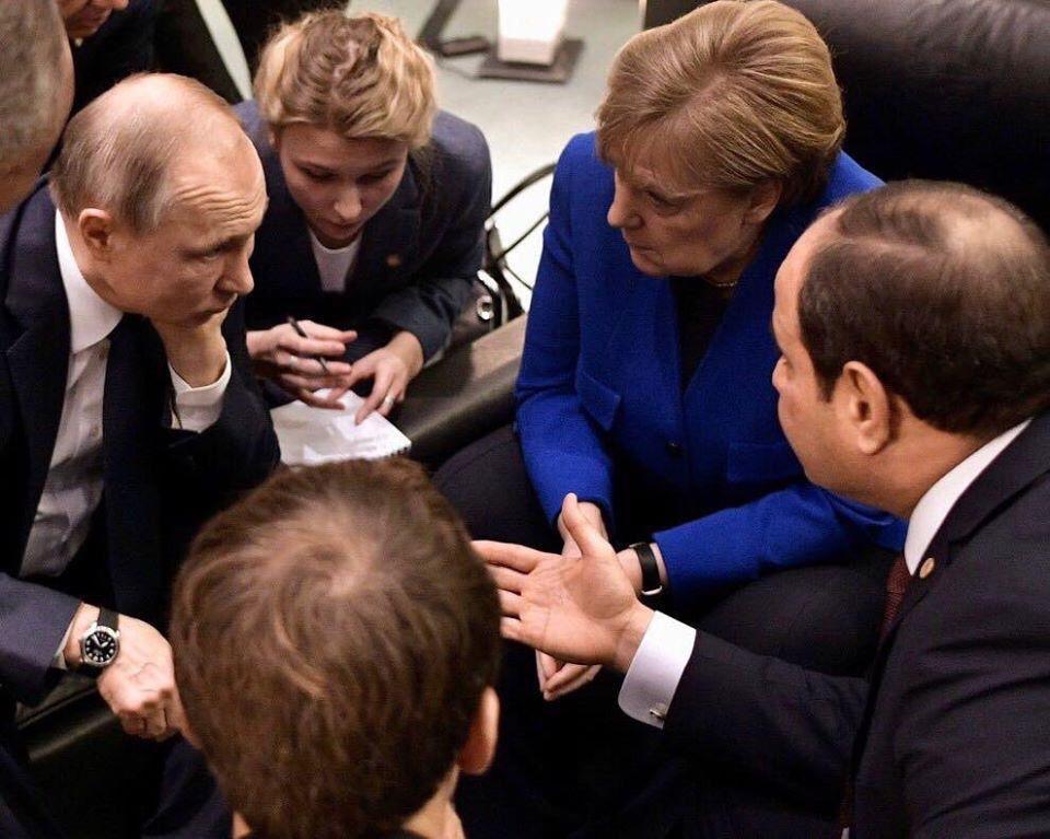 السيسي مع بوتين وأنجيلا ميركل