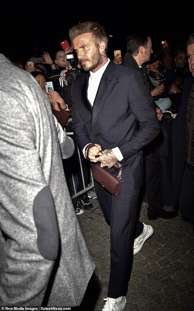 ديفيد بيكهام يحضر عرض أزياء Dior